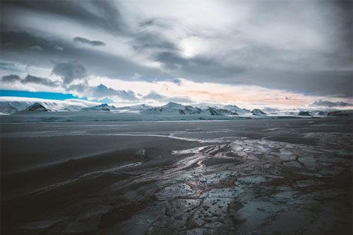 Cloudy skies over ice polar landscape