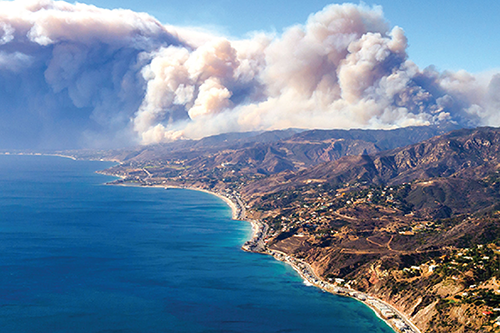 Plumes of wildfire smoke along the California coastline.