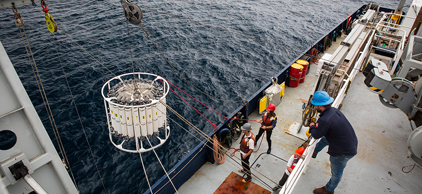 Ship crewmembers deploy a CTD rosette, a staple measurement method in CalCOFI cruises. Photo: Natalya Gallo