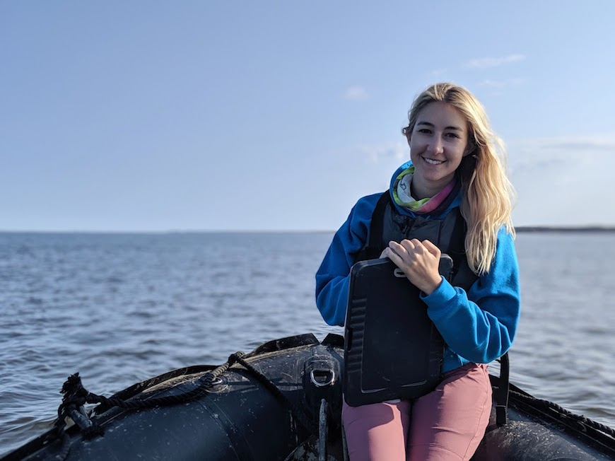 Master's student Jessica Sportelli on a Zodiac in the Churchill River in Canada.