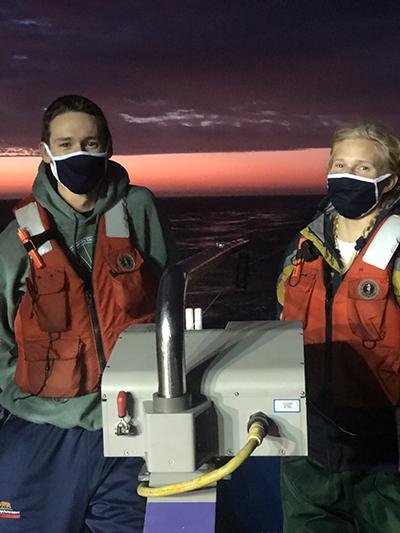 Students Jess Hunt (left) and Evie Gedminas staff a winch during a dawn shift. Photo: Jess Hunt