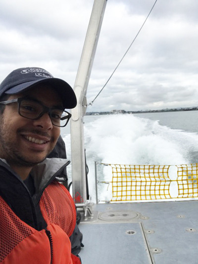 A young man on a research vessel at sea
