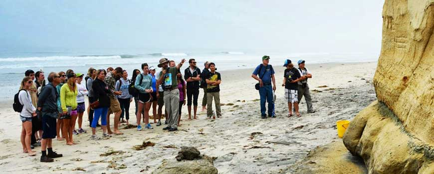 Prof. Dick Norris lectures students during a field trip to Torrey Pines.