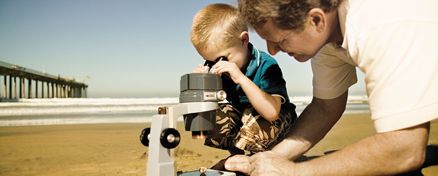 Father and boy with microscope