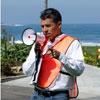 Man in safety vest holding bullhorn