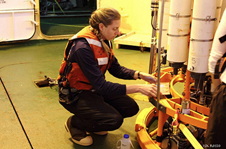 Tamsitt preparing instruments on the CTD for deployment on the RV Palmer in 2014. Photo credit Isa Rosso.