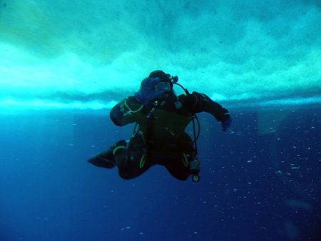"Jessica Meir scuba diving under the sea ice at a research camp called ""Penguin Ranch"" in McMurdo Sound."