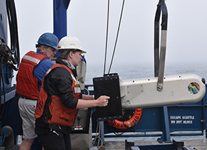 Stephanie Sommer operates a moving vessel profiler, an instrument that rises and sinks in the top 200 meters of water