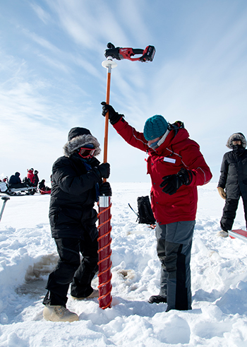 Scientists practice coring sea ice near Pt. Barrow, Alaska in preparation for MOSAiC