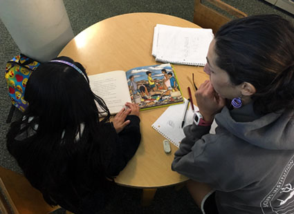 Isabella Arzeno tutors a middle school student.