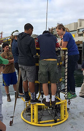 Tamsitt teaching high school students how to set up a CTD on the RV Sproul in San Diego Bay. Photo Credit Julia Fiedler.