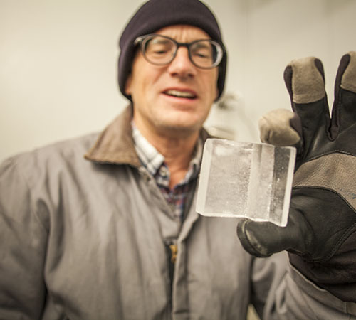 Severinghaus examines an ice core at Scripps Institution of Oceanography.