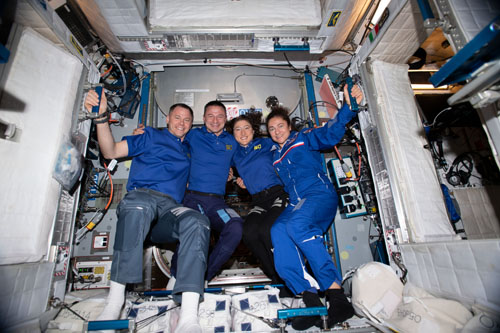 NASA astronauts Nick Hague, Andrew Morgan, Christina Koch and Jessica Meir, all members of the Astronaut Class of 2013, pose for a portrait aboard the International Space Station. Photo: NASA