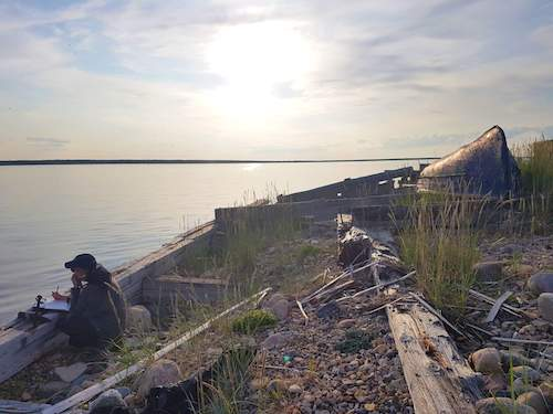 Master's student Jessica Sportelli conducting observations from a dock along the Churchill River in Canada.