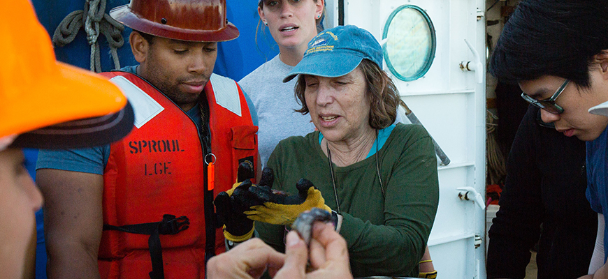 Biological oceanographer Lisa Levin describes deep-sea organisms to students during a recent field course. Photo: Cody Gallo