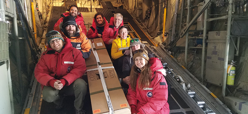 Scripps graduate student Maya Becker (bottom right), colleagues prepare to deploy an ALAMO float near Ross Ice Shelf, 2016.