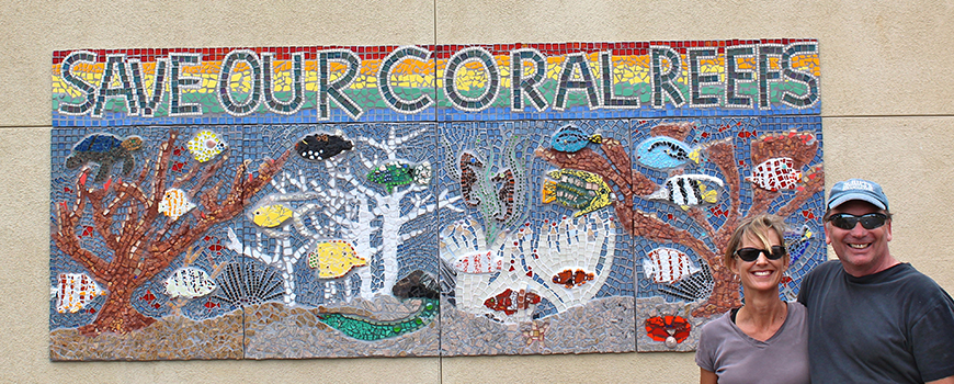 "Tim Lueker with wife Chris next to the ""Save Our Coral Reefs"" mosaic in Encinitas, Calif."