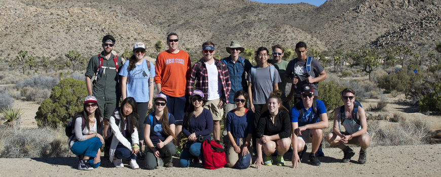 A group of students and professors in the desert.