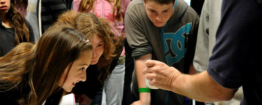 "Students watch as a scientist conducts an experiment at the first ever ""Exploring Ocean Careers"" event."