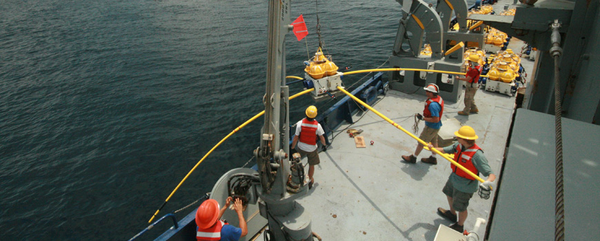 Scientists prepare to deploy an electromagnetic instrument during a 2010 expedition aboard R/V Melville off Nicaragua.