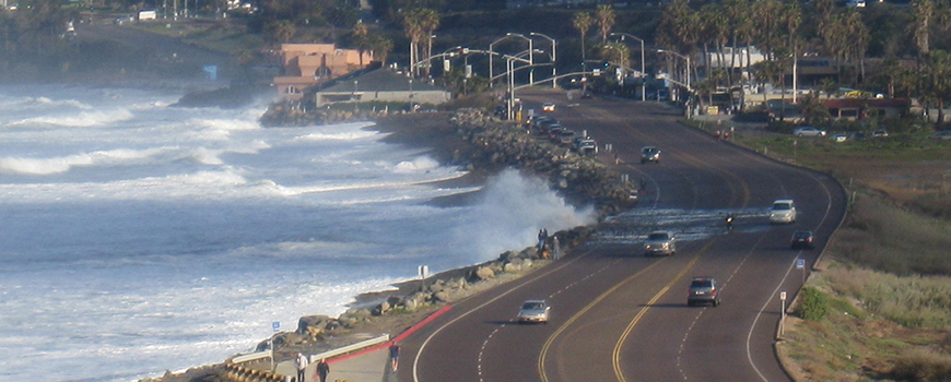 Waves reach Highway 101 north of Solana Beach, Calif. in 2010.