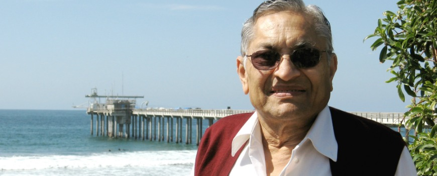 A man standing in front of a pier.