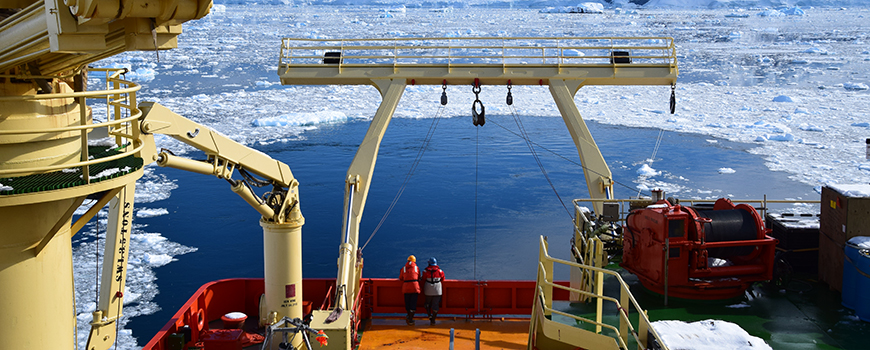 Deployment of instrument to measure light scattering in ocean off R/V Laurence M. Gould during FjordEco cruise