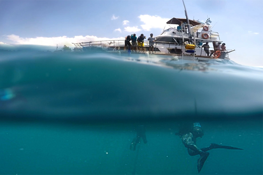 A boat and divers in the water.