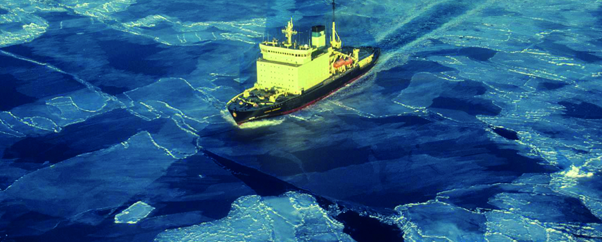 Ship navigates through sea ice