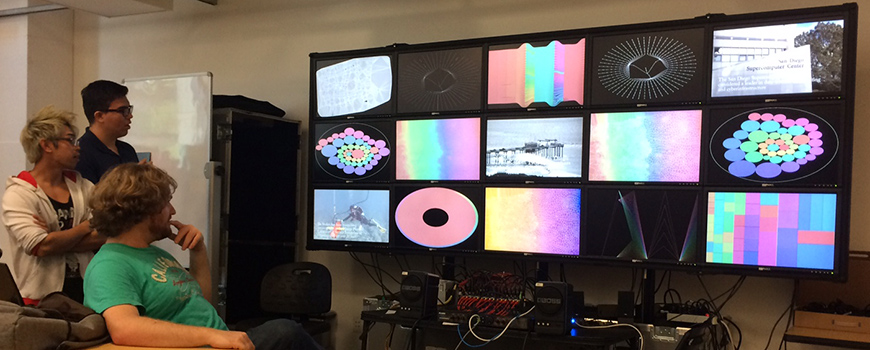 UC San Diego students show off a 'visualization cluster' to Birch Aquarium at Scripps staff in June