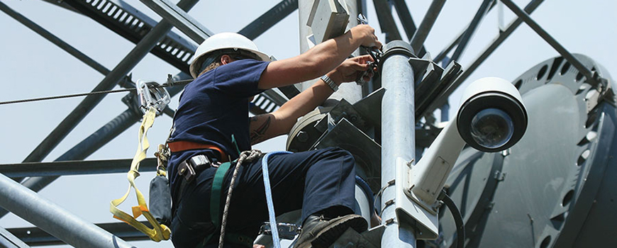 Antenna installation on a microwave tower to connect a nearby fire station to HPWREN. Courtesy of HPWREN/SDSC