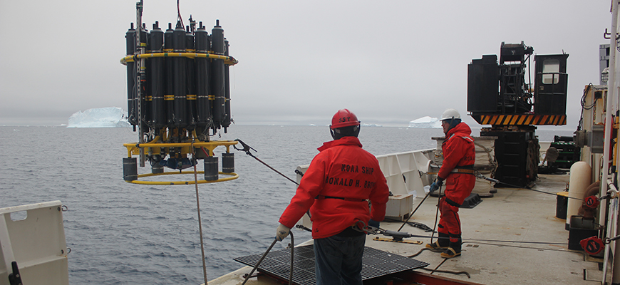 Crew of NOAA Ship Ronald M. Brown deploy a CTD, an instrument that collects ocean temperature and other data