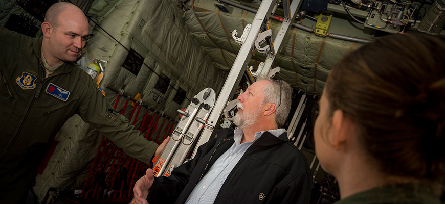 "Scripps meteorologist with Air Force personnel aboard ""Hurricane Hunter"" aircraft. Photo: Erik Jepsen/UC San Diego"