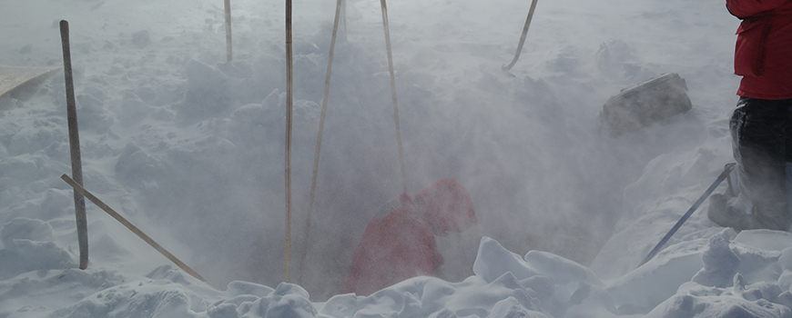 Servicing a seismic station in subzero temperatures and high winds. Photo courtesy of Spencer Niebuhr
