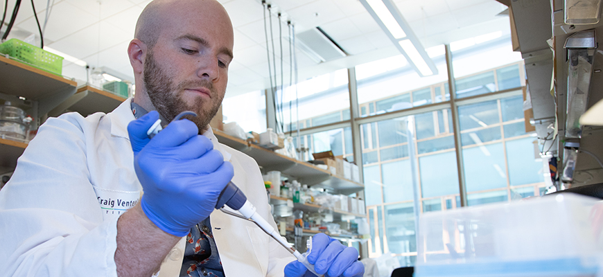 Patrick Brunson pipettes Pseudo-nitzschia diatoms at Andrew Allen Lab at the J. Craig Venter Institute. Photo: JCVI