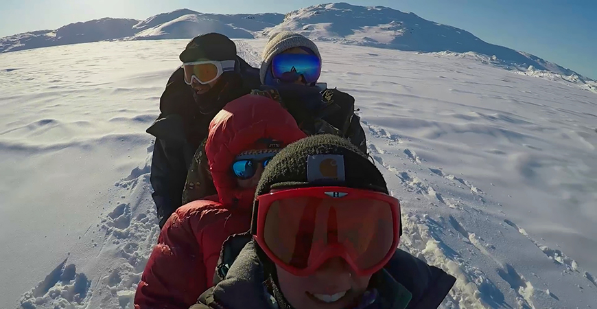 Scientists traveling across Greenland's sea ice via dogsled. Photo: Margaret Lindeman