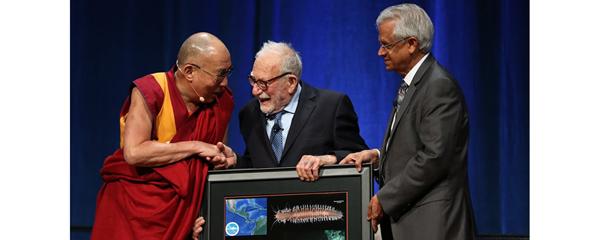 The Dalai Lama accepts a gift from Scripps Oceanography scientists Walter Munk and V. Ramanathan on his 80th birthday