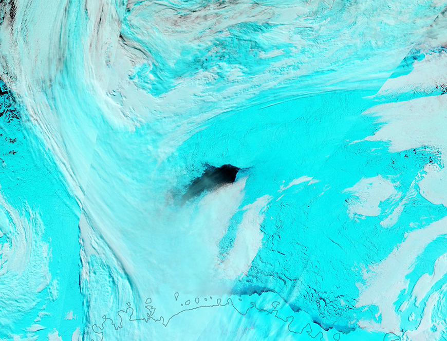 Weddell Sea polynya, initally 3,700 square miles, 2017. False color NASA satellite image shows ice in blue, clouds in white.