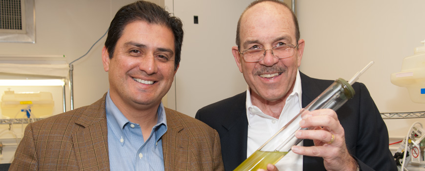 State Senator Ben Hueso and Dominick Mendola in the Scripps algal biofuel laboratory.