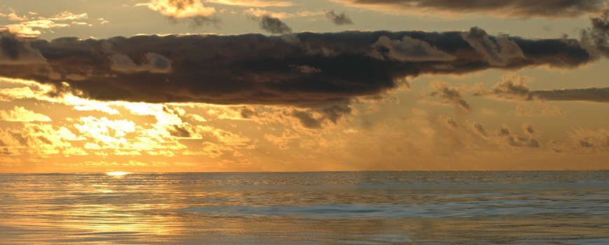 Sunset at sea by J. Leichter