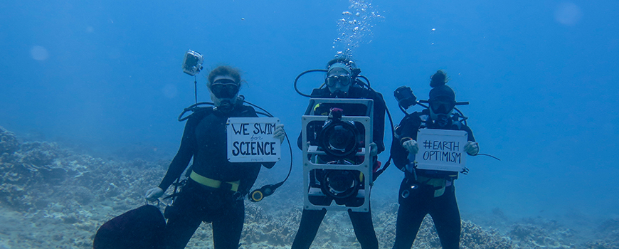 Researchers take part in the EarthOptimism and March for Science underwater off Maui, April 22