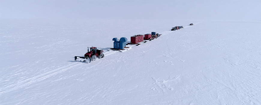 Vehicles towing gear on Antarctic ice