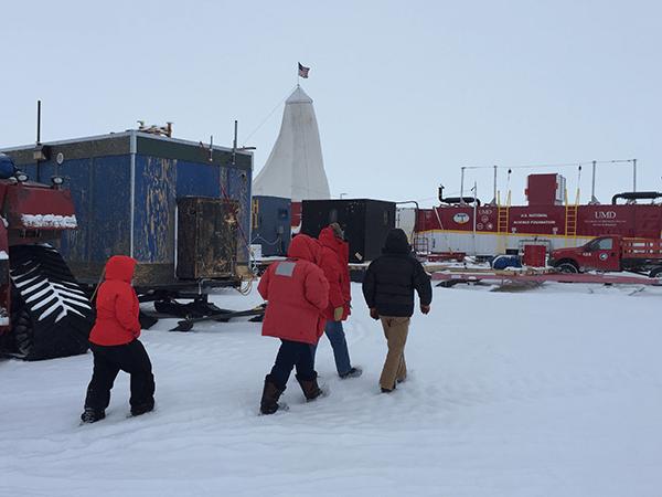 Researchers in Antarctic snow