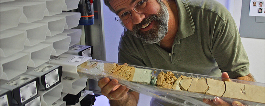 Paleobiologist Richard Norris with a sediment core from the Cretaceous-Paleogene (K/Pg) boundary
