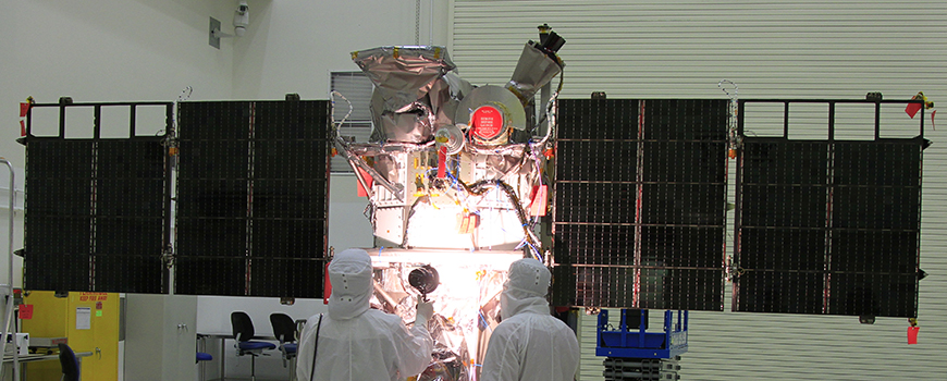 Workers conduct a light test on the solar arrays on DSCOVR. Photo: NASA/Ben Smegelsky