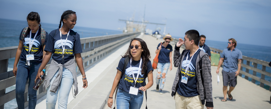 Students walk on a pier.