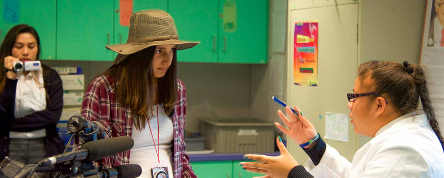 Students film a scene for a class project.
