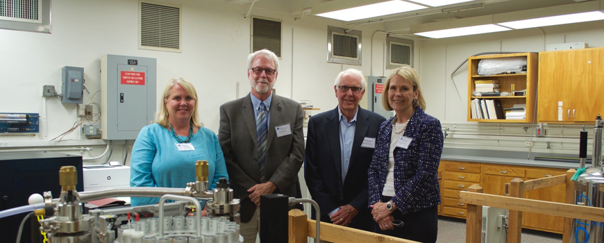 Donors and faculty visit a research lab.