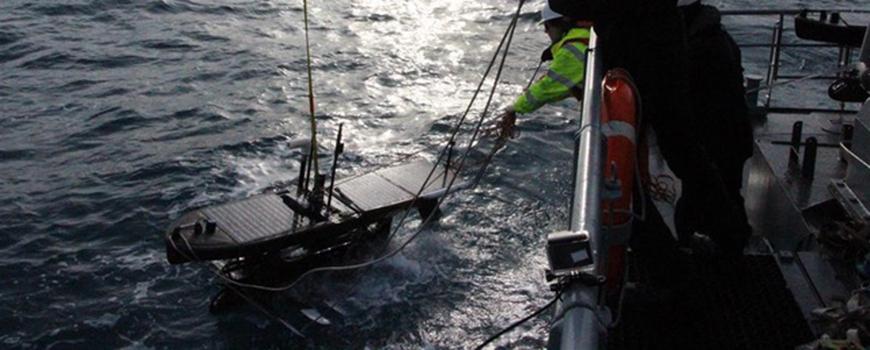 The crew of Icelandic Coast Guard survey vessel Baldur deploys a Wave Glider for measuring winds, Feb. 22, 2017