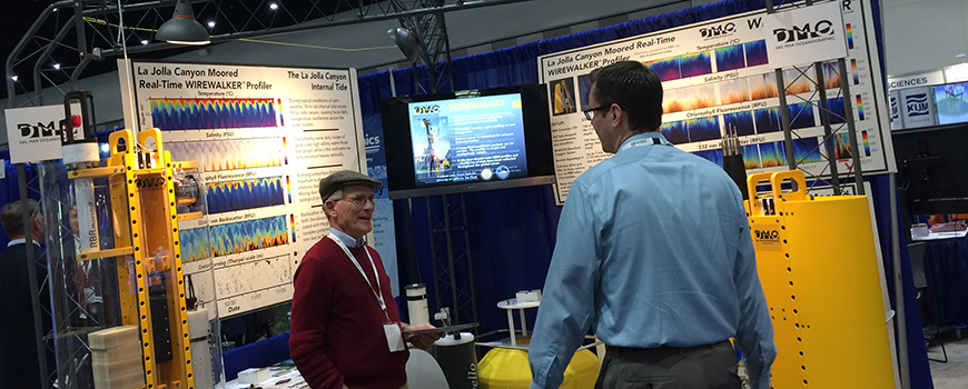Scripps oceanographer Rob Pinkel (left) describes the Wirewalker instrument at Oceanology International